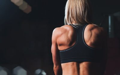 a woman showing her perfectly toned muscle in the back