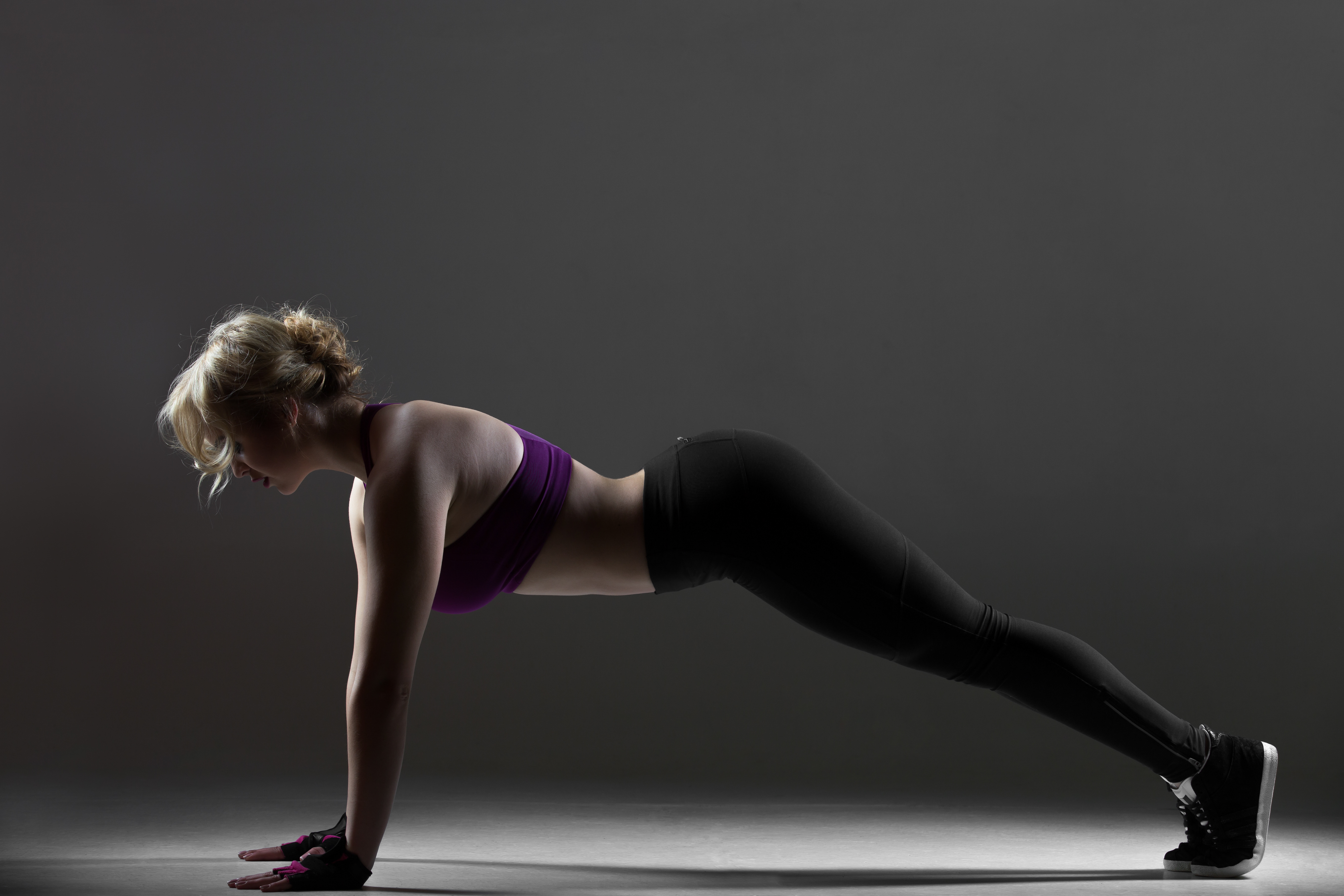 beautiful sporty girl doing push ups